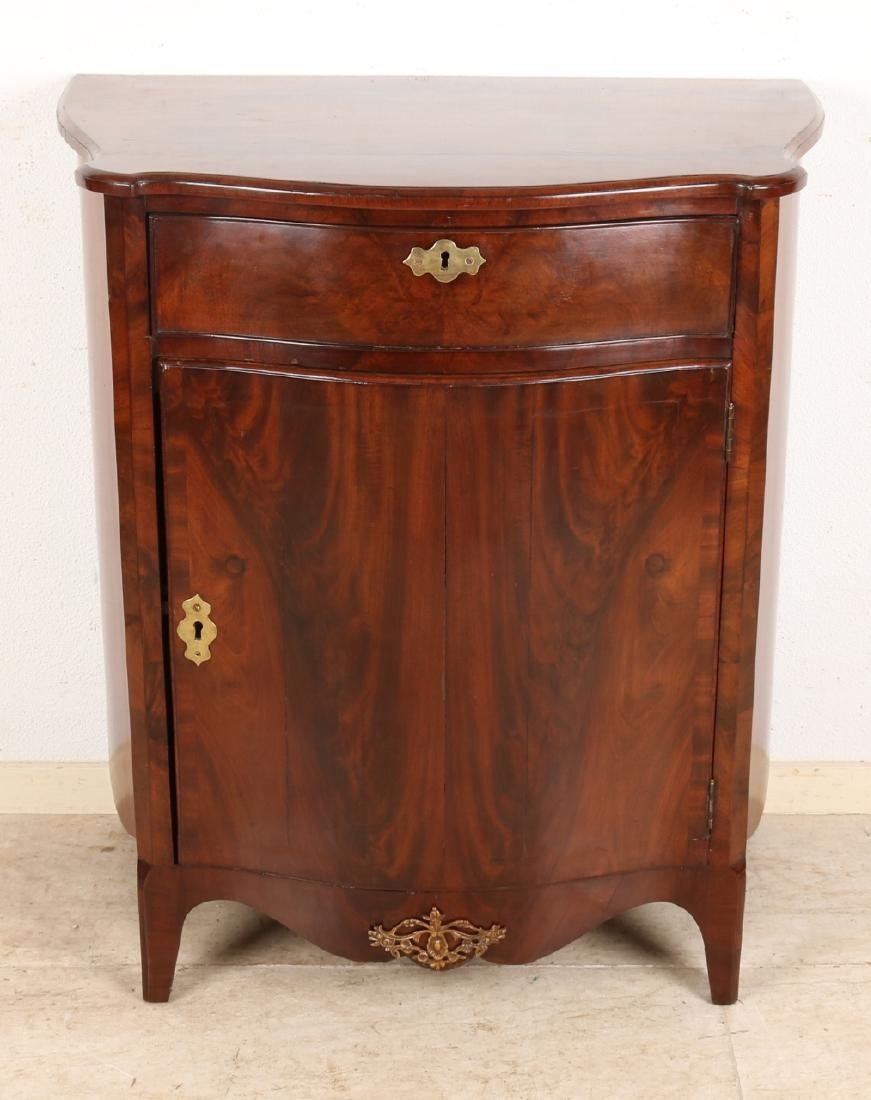 Early 19th century mahogany single-door chest of drawers with curved front. Loui