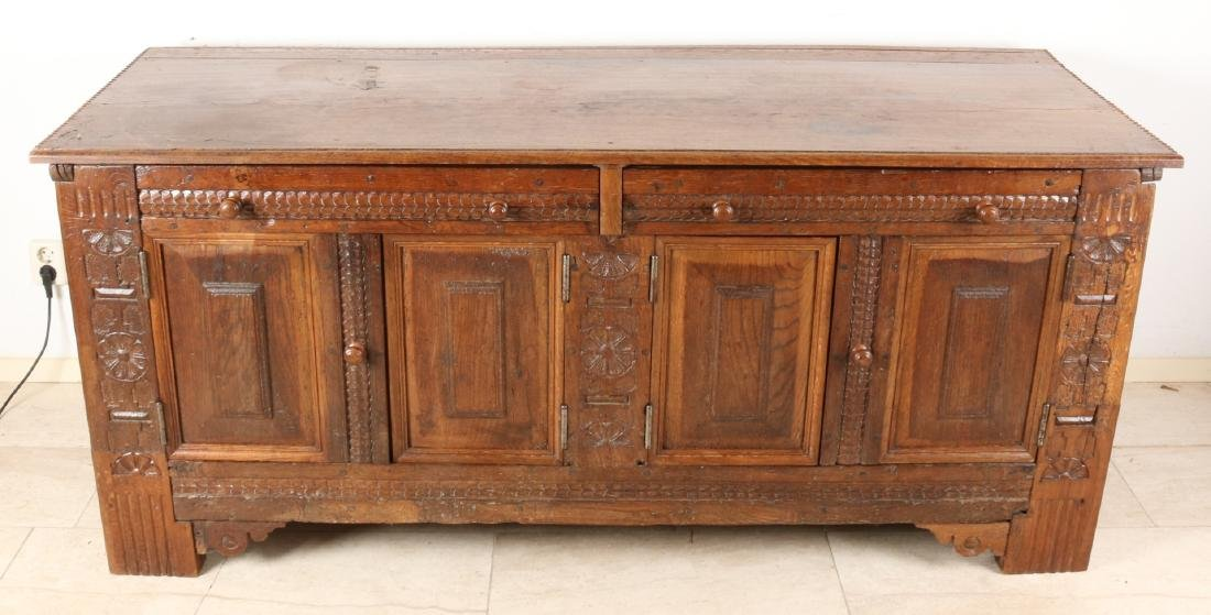 Early 18th century converted oak Dutch blanket box with doors and drawers. Size: