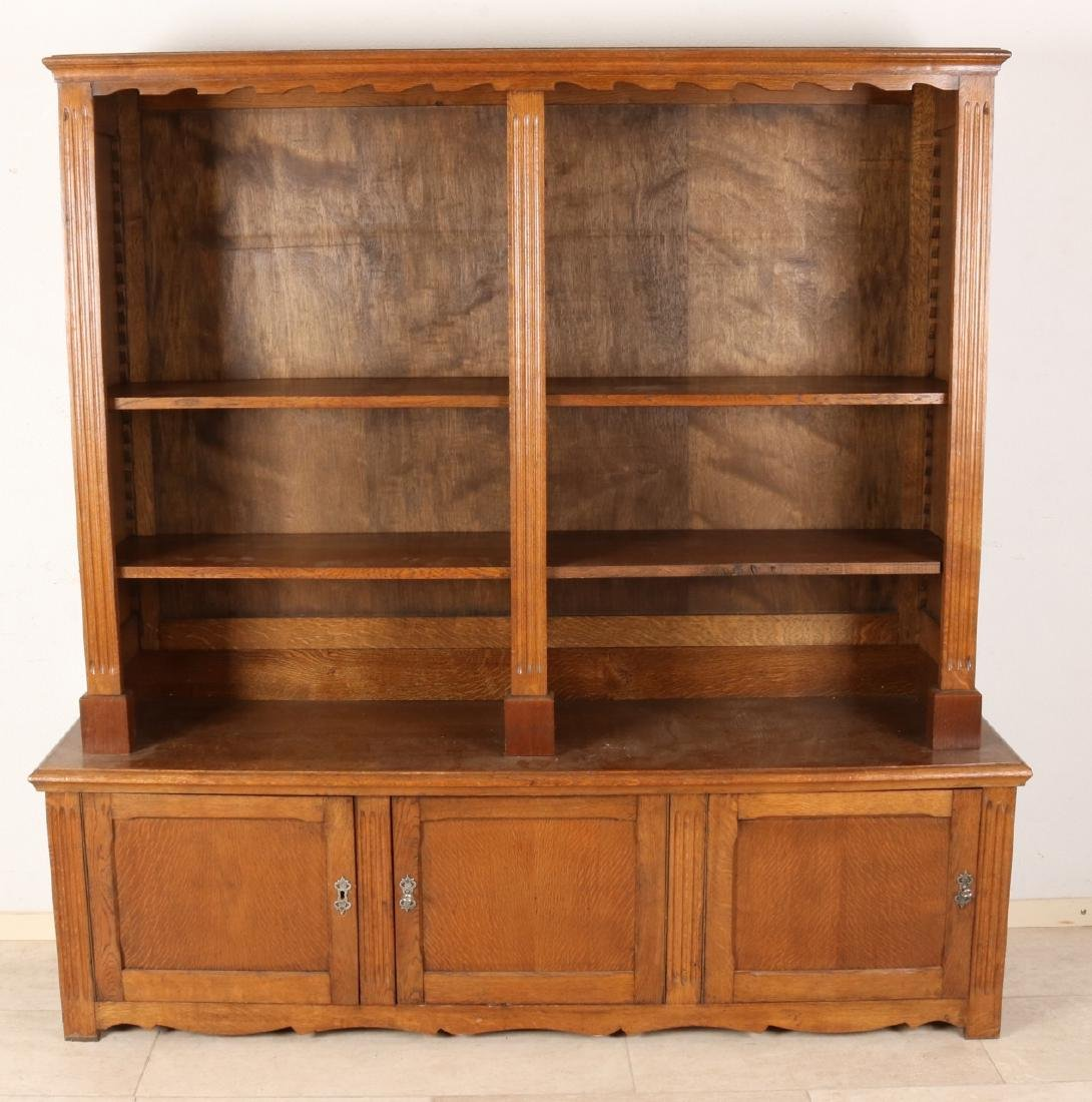 Old oak wood bookcase. Two-piece with shelves and three lockable doors. Second h