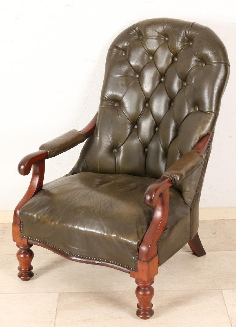19th Century mahogany English voltaire with brown leather upholstery. Beautiful