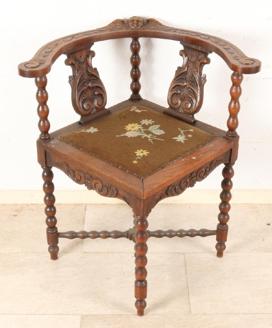 19th Century French wood-stained historicism chair with cherub head and twisted