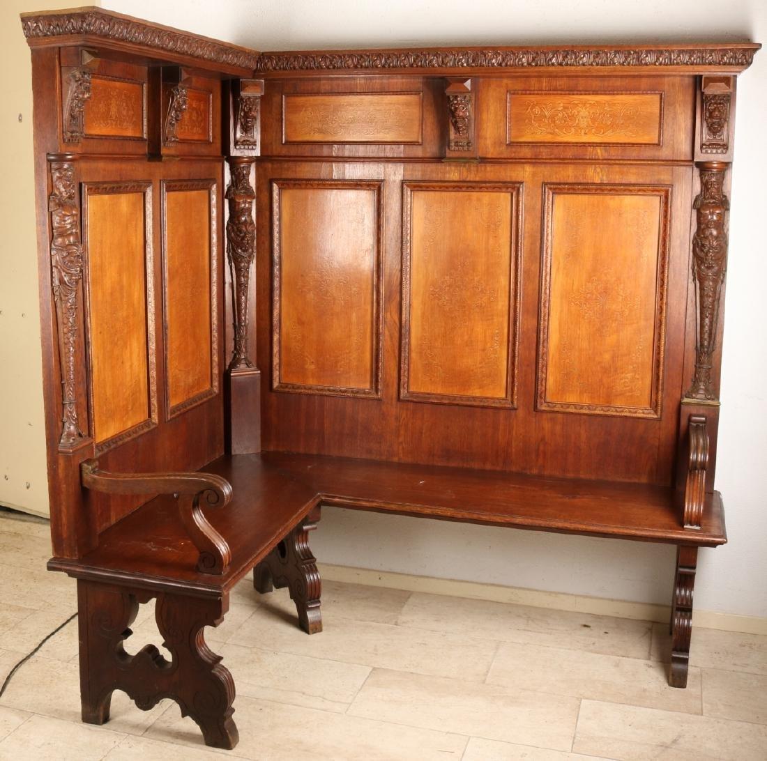 Rare large Dutch 19th century Neo Renaissance oak corner sofa with torsos, lion