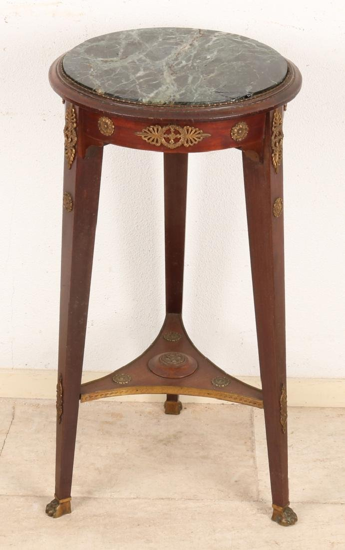 Antique French mahogany side table with bronze fittings and marble top. Restored
