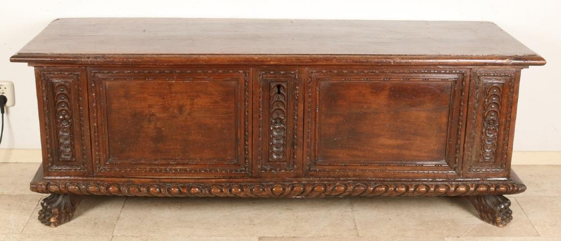 Antique Italian renaissance walnut box with antique lock. Standing on claw feet.
