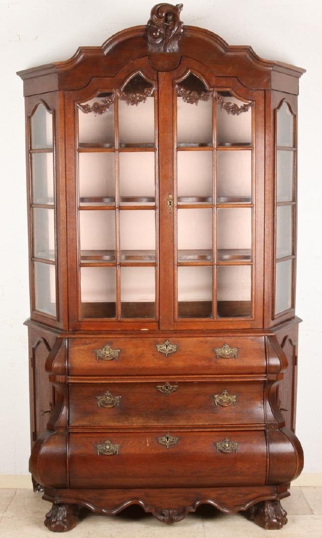 19th Century Dutch oak Baroque display cabinet. With side doors next to the draw