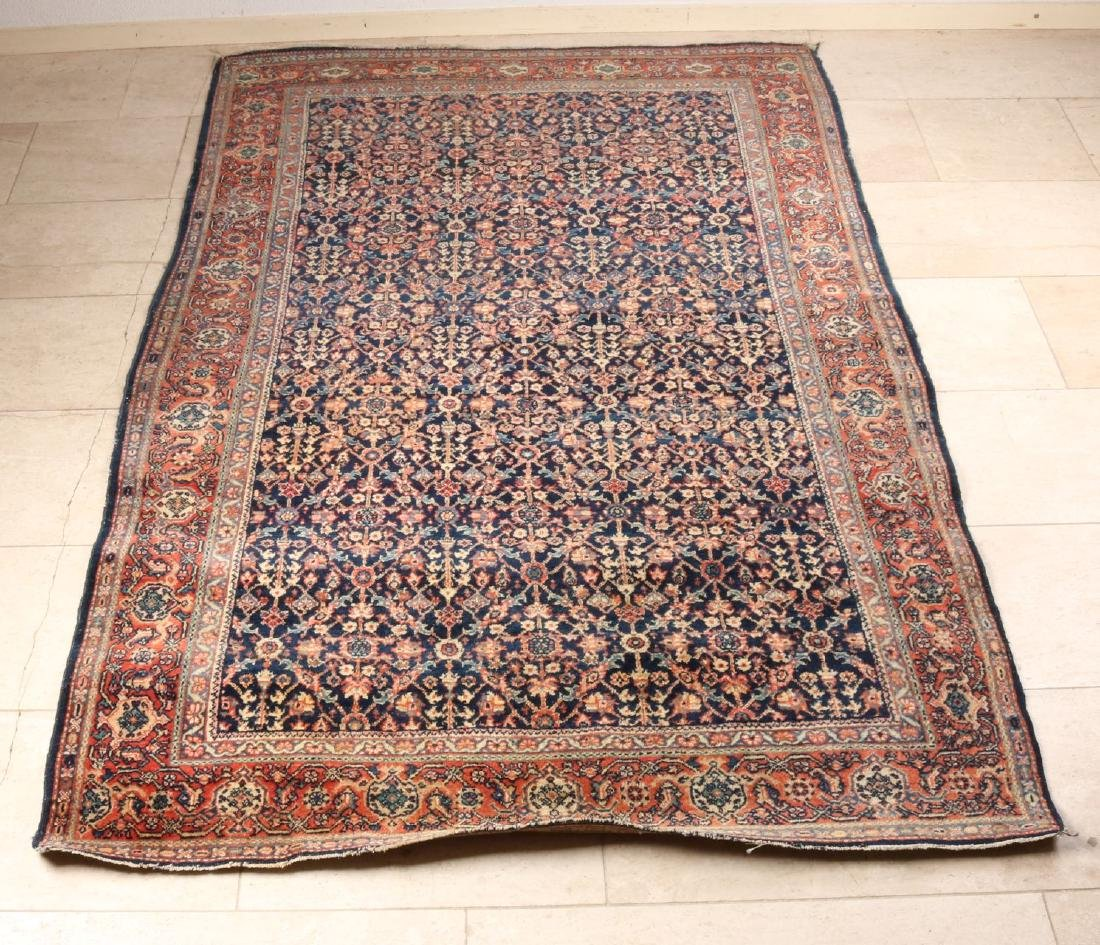Finely knotted old Persian rug with floral decors, in earth tones and blue. Size