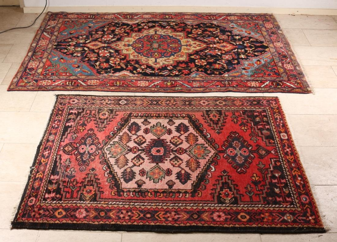 Two old Persian rugs. Multi-colored. Size: 110 x 146 cm + 208 x 125 cm. In good
