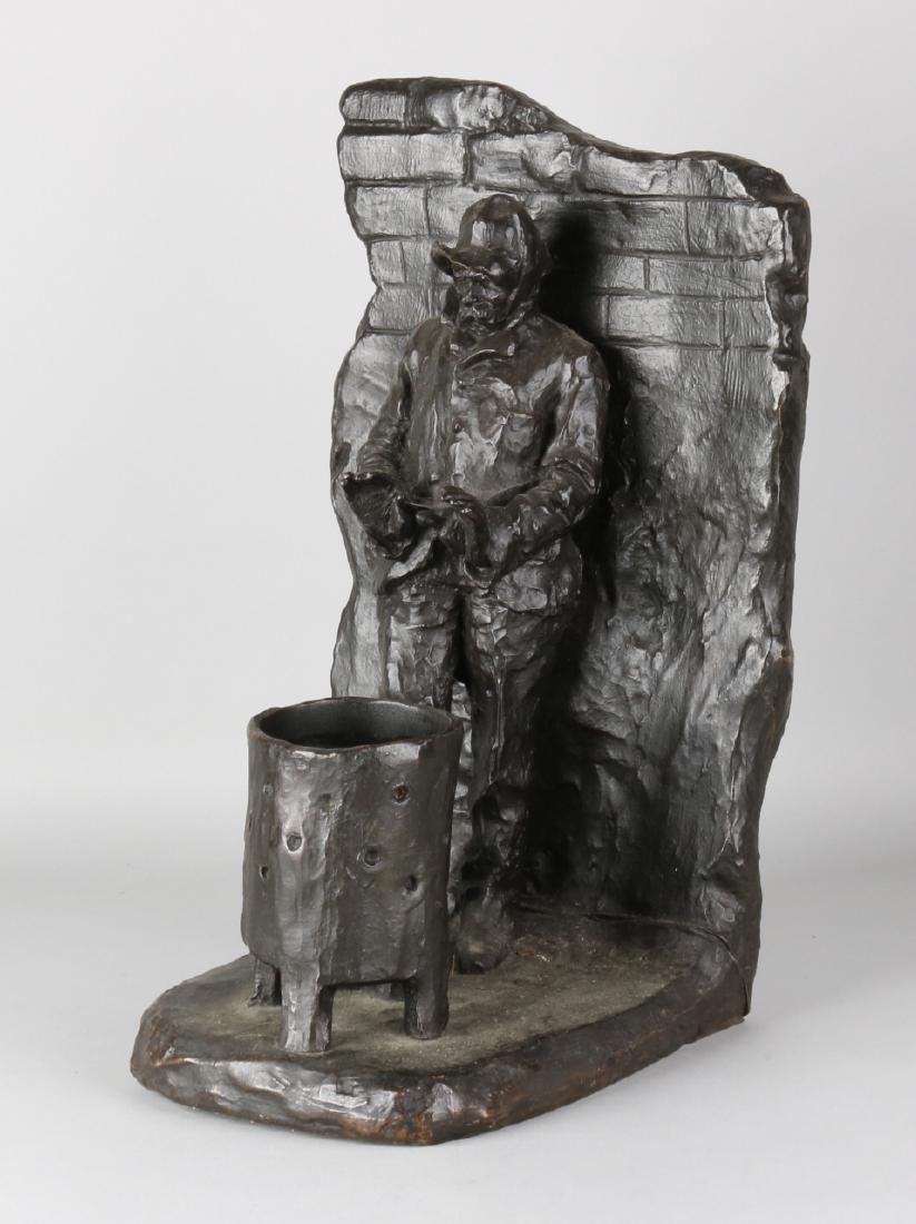 Large antique bronze figure. Man at fire pit. Circa 1910. Size: 45 x 22 x 28 cm.
