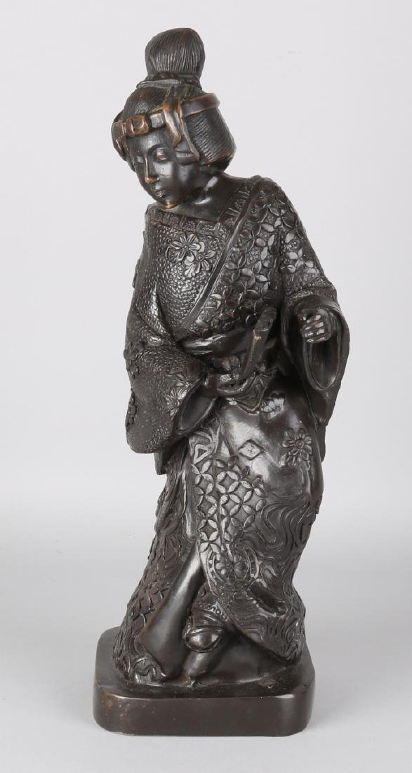 Japanese bronze Geisha with fan. 20th century. Size: 44 cm. In good condition.