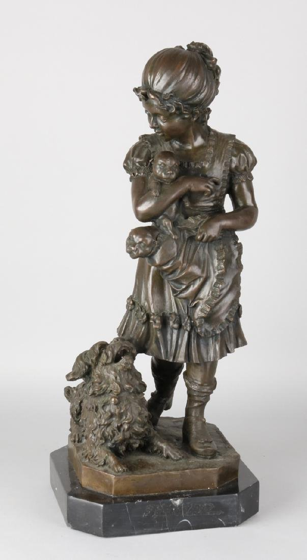 Large bronze figure on black marble base. Girl with dogs. Signed F. Barbedienne.