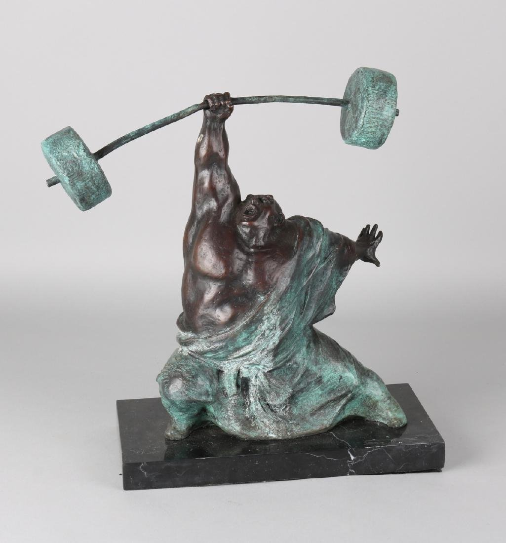 Green patinated bronze figure on black marble base. Weight lifting Chinese. 21st