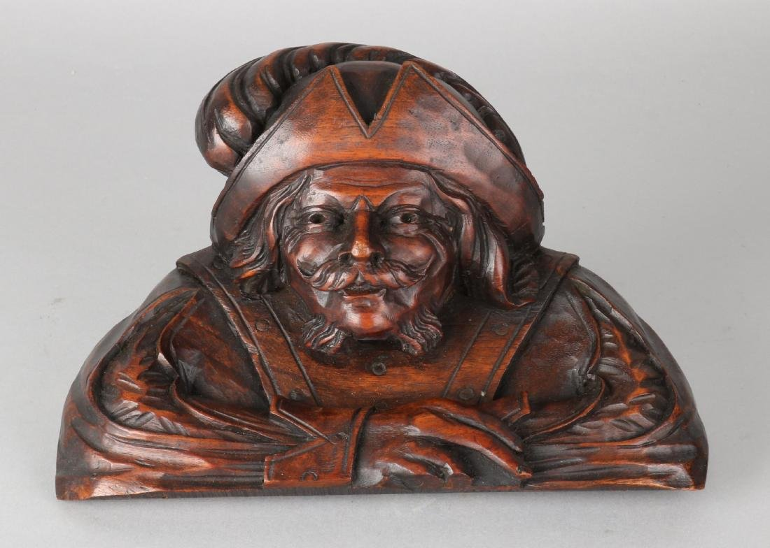 19th Century French walnut carved bust of an 18th century man. Size: 16.5 x 25 x