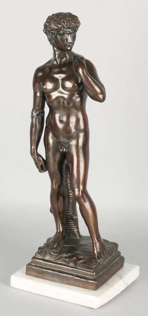 Antique Roman figure. Male nude on marble basement. Arm restored. Size: 42 cm. I
