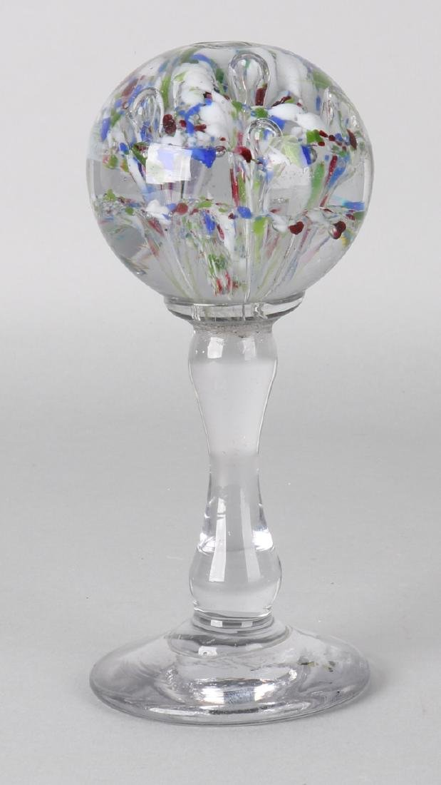 Antique glass paperweight with colored flower and air bubbles. Meisenthal. Size: