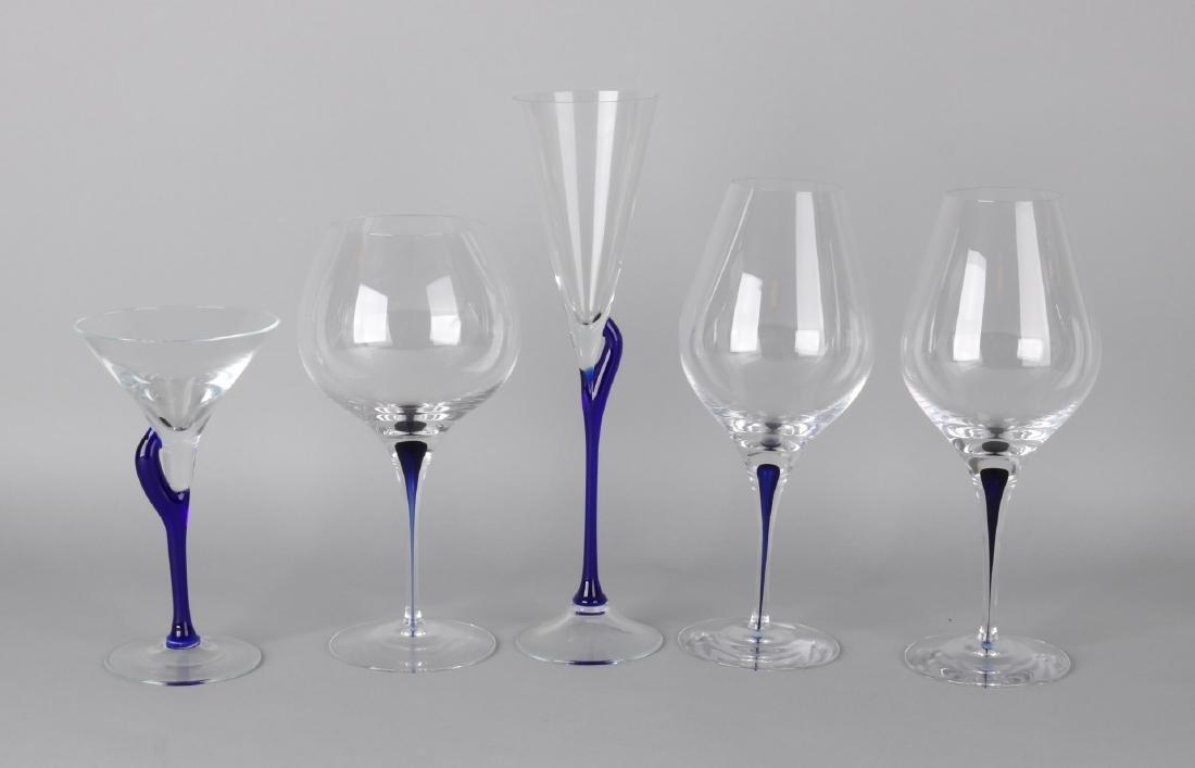 Five Orrefors design glasses with blue stem. Intermezzo, Sweden. 21st century. S