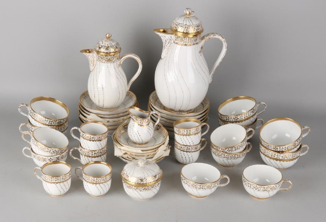 German KPM porcelain coffee / mocha dinnerware with gold decor. 20th century. Co