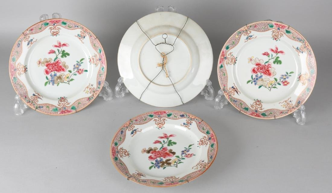 Four 18th century Chinese porcelain plates with enamel painted floral decors and