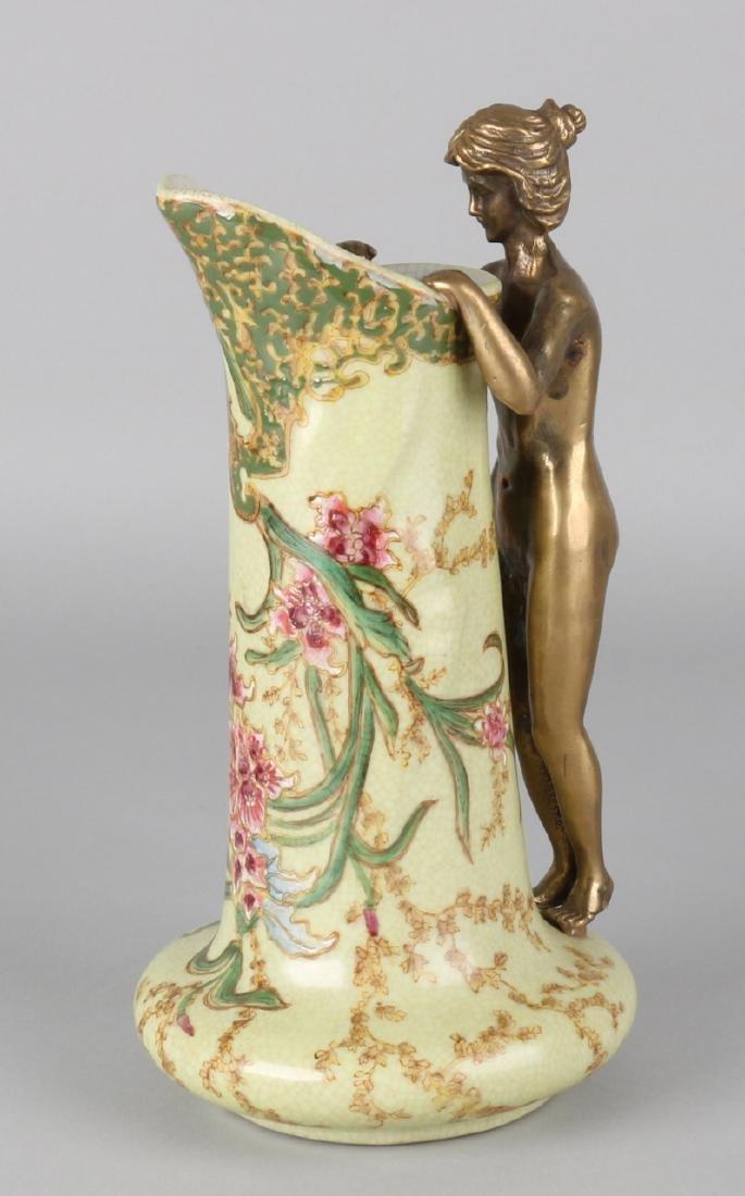 Ceramic Art Nouveau style jug with bronze naked lady. 21st century. Size: 23 cm.