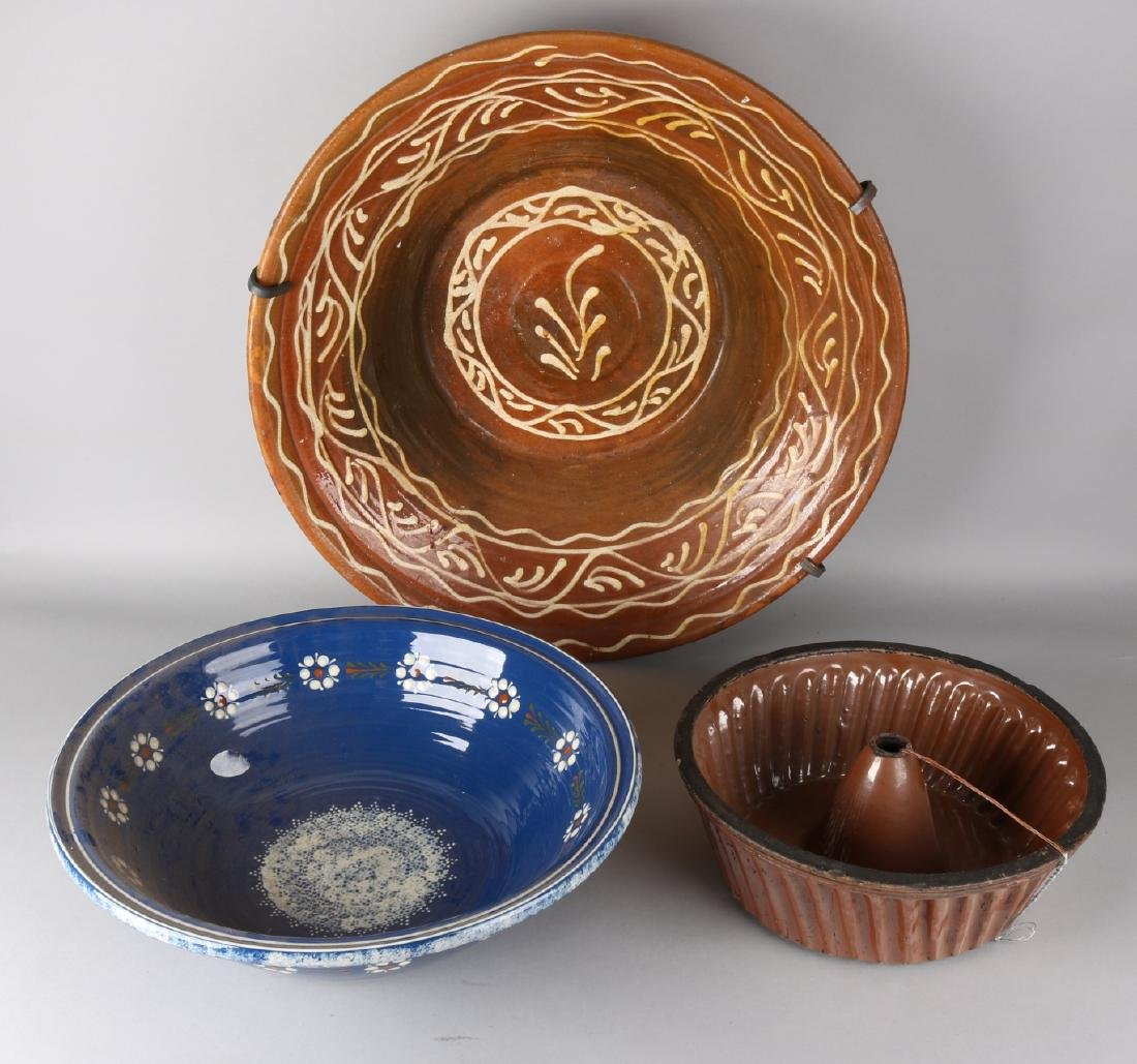 Three volumes of large German 19th century ceramics. One brown glazed large cake