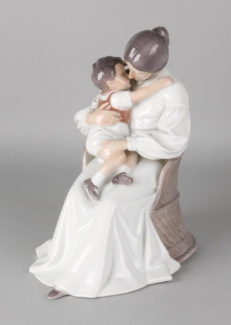 Large Royal Copenhagen porcelain sculpture. Mother with boy. With initials IPI 1