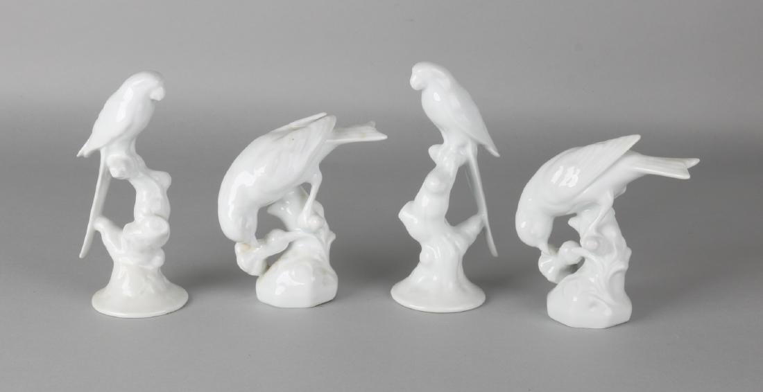 Four German white-porcelain birds. 20th century. Numbered. Size: 14 - 17 cm. In