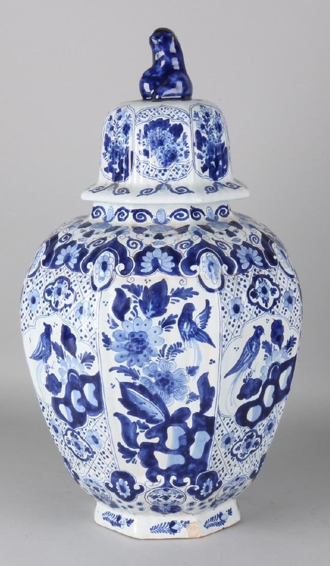 Large antique Delft blue ceramic vase. Signed APK. Ribbed and eight-sided. Circa