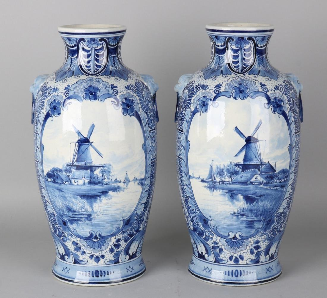 Two antique Delft Porceleyne Fles ceramic ornamental vases with landscapes decor