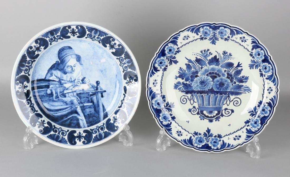 Two Delft blue decorative plates. 20th century. One time old Delft, after Jan Ve