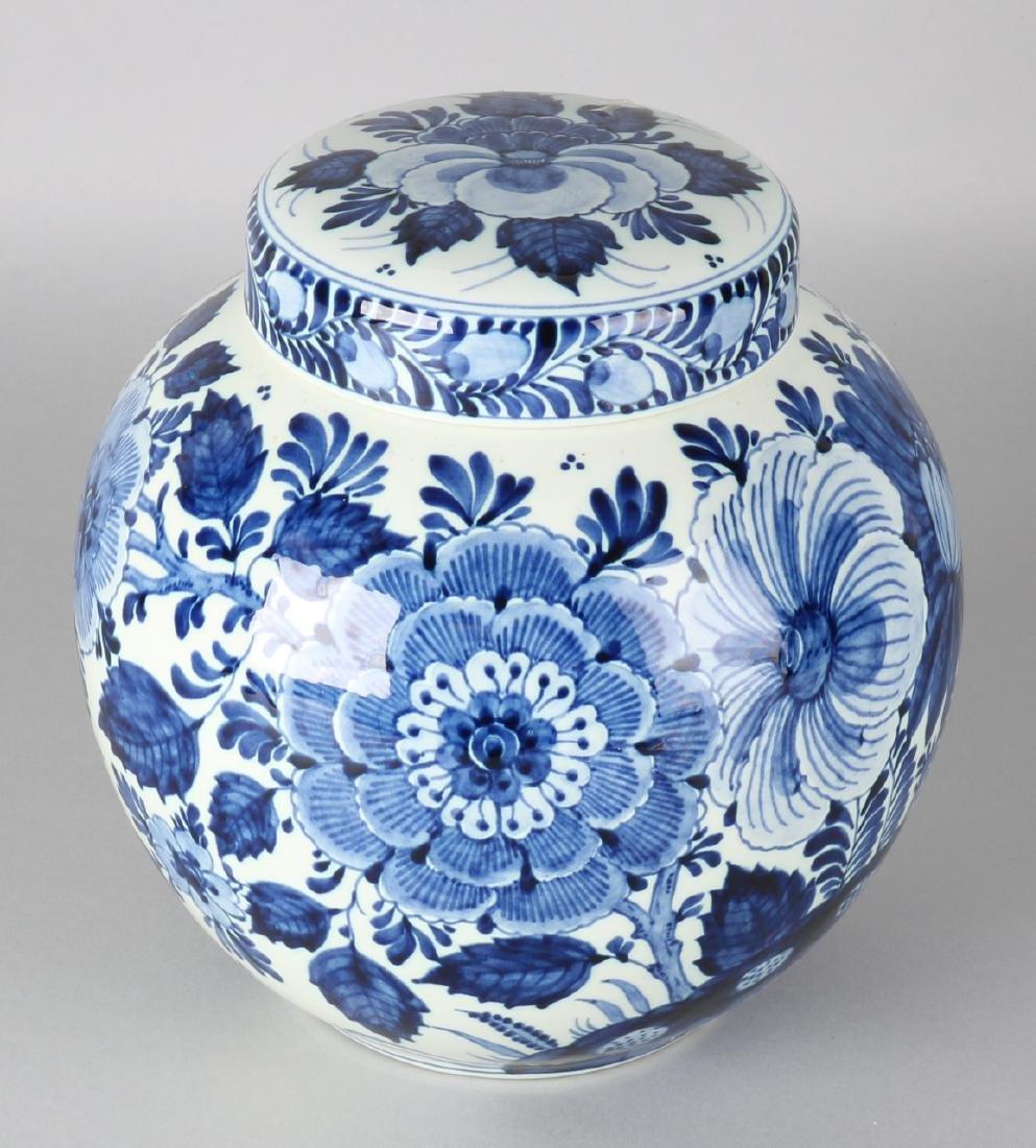Large Ram Arnhem Delft blue ceramic ginger jar with floral decors. Circa 1930. S