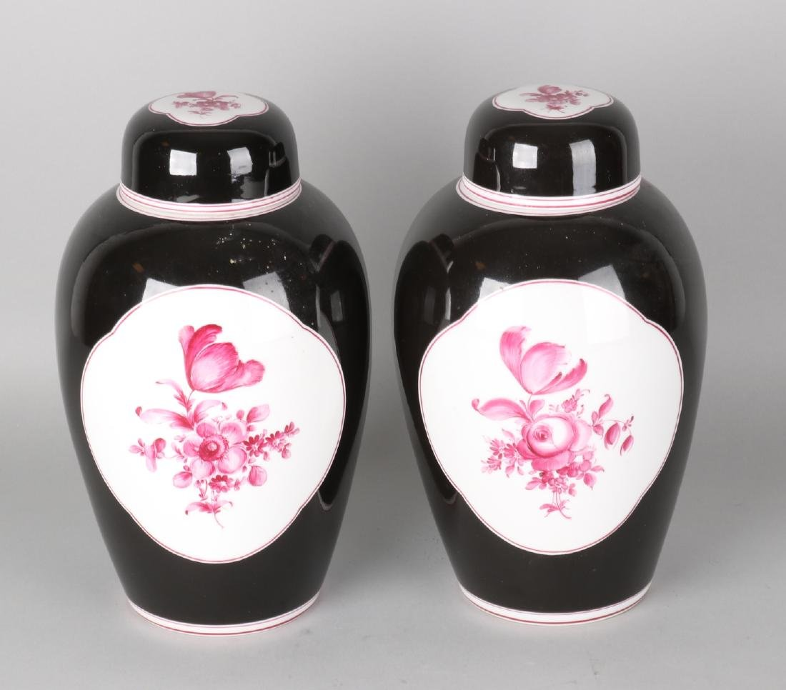 Two antique German Nymphenburg porcelain lid vases with black glaze and hand-pai