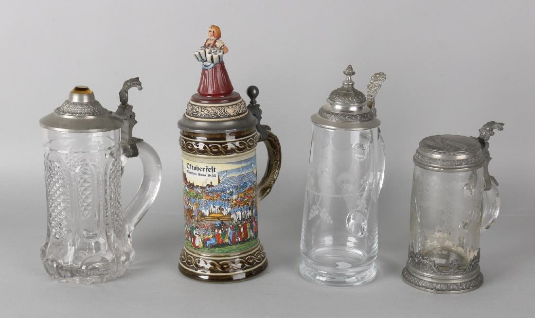 Four old German beer mugs. 20th century. Glass and porcelain with tin lids. Size
