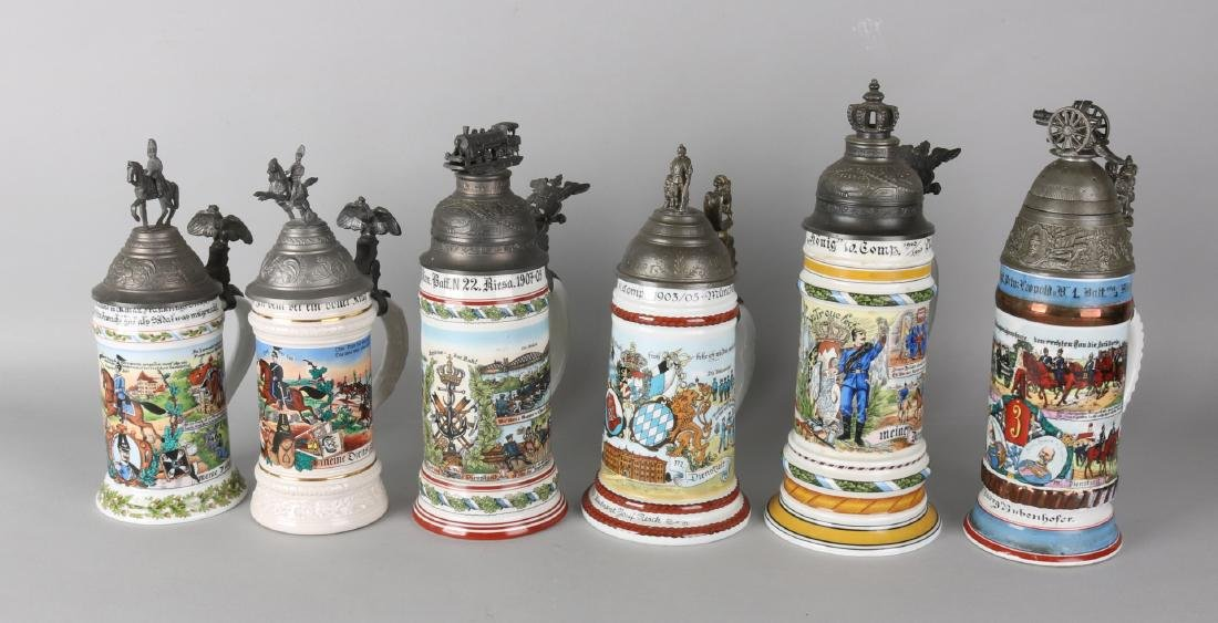 Six old German porcelain reservists beer mugs with tin lids. Size: 26 - 31 cm. I