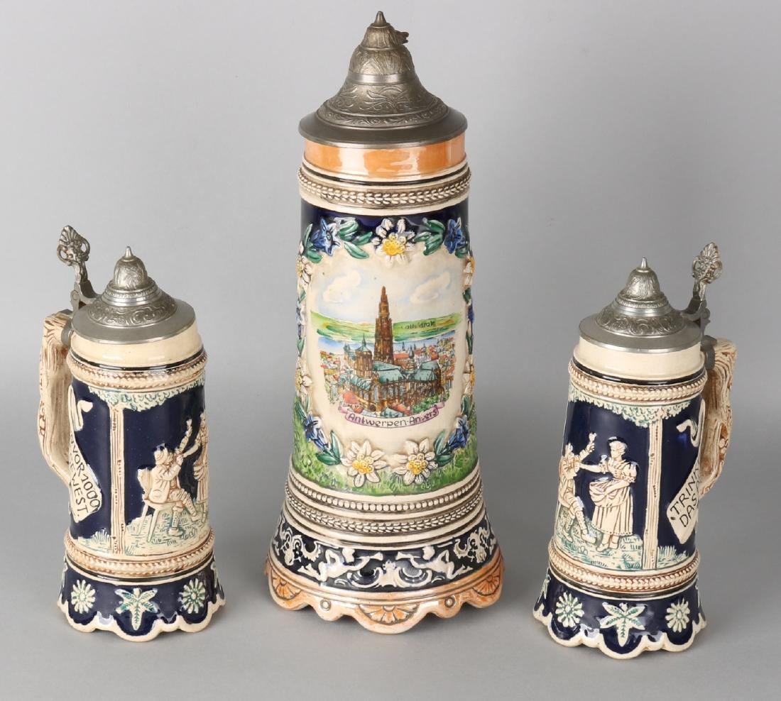 Three old German stoneware beer mugs with music box. 20th century. Size: 22 - 34