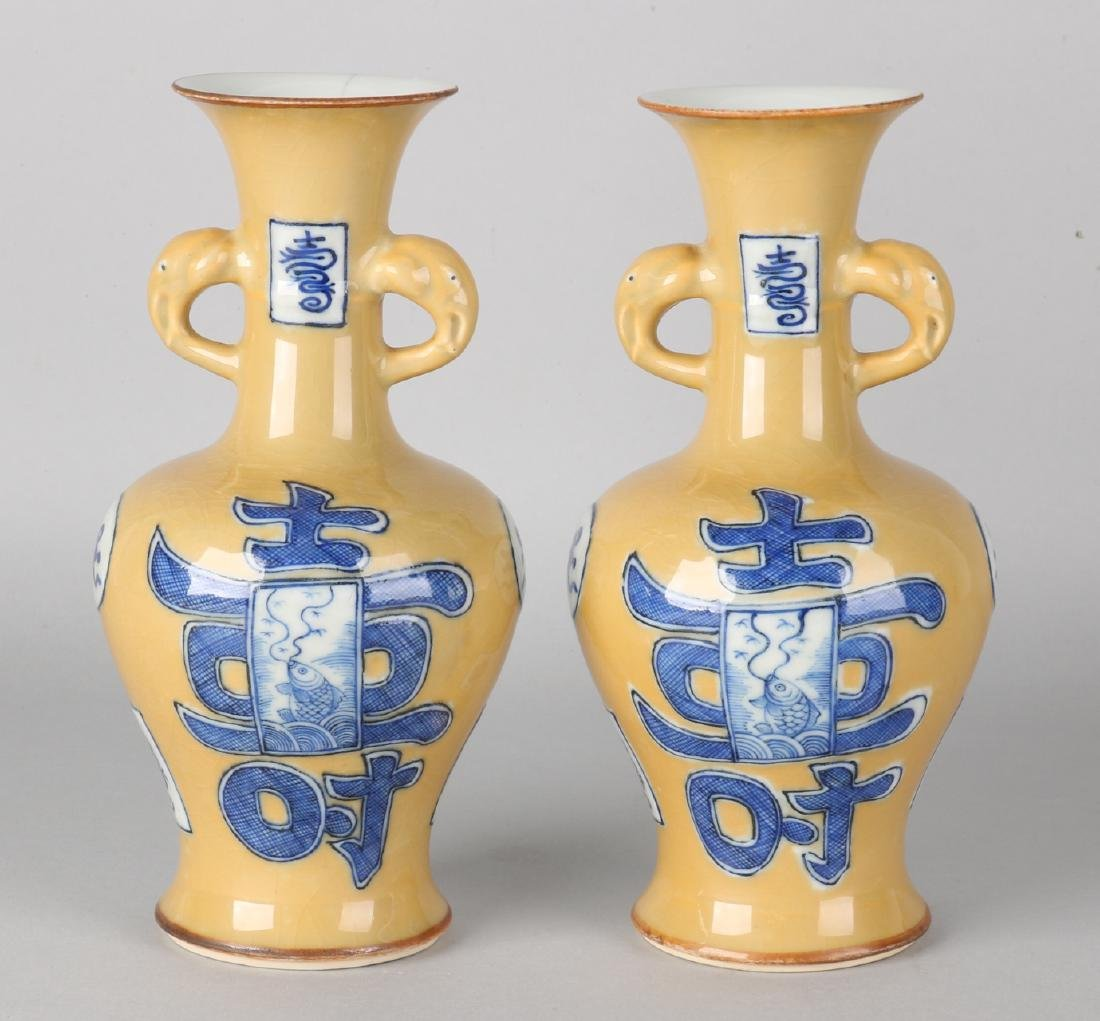 A pair of Kang Xi branded Chinese porcelain vases with light brown crackle glaze