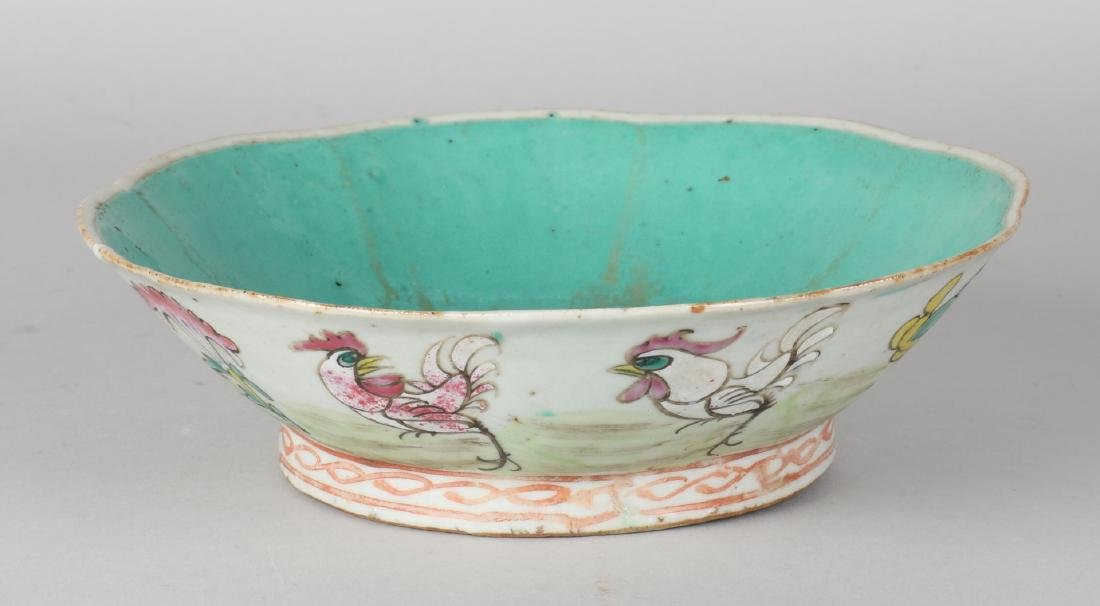 Chinese porcelain chicken dish with chickens and floral decors. First half of 20