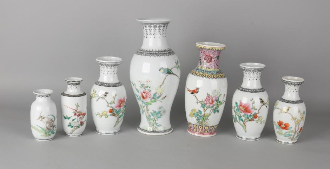 Seven old Chinese porcelain vases with floral and bird decors and signs. Soil br