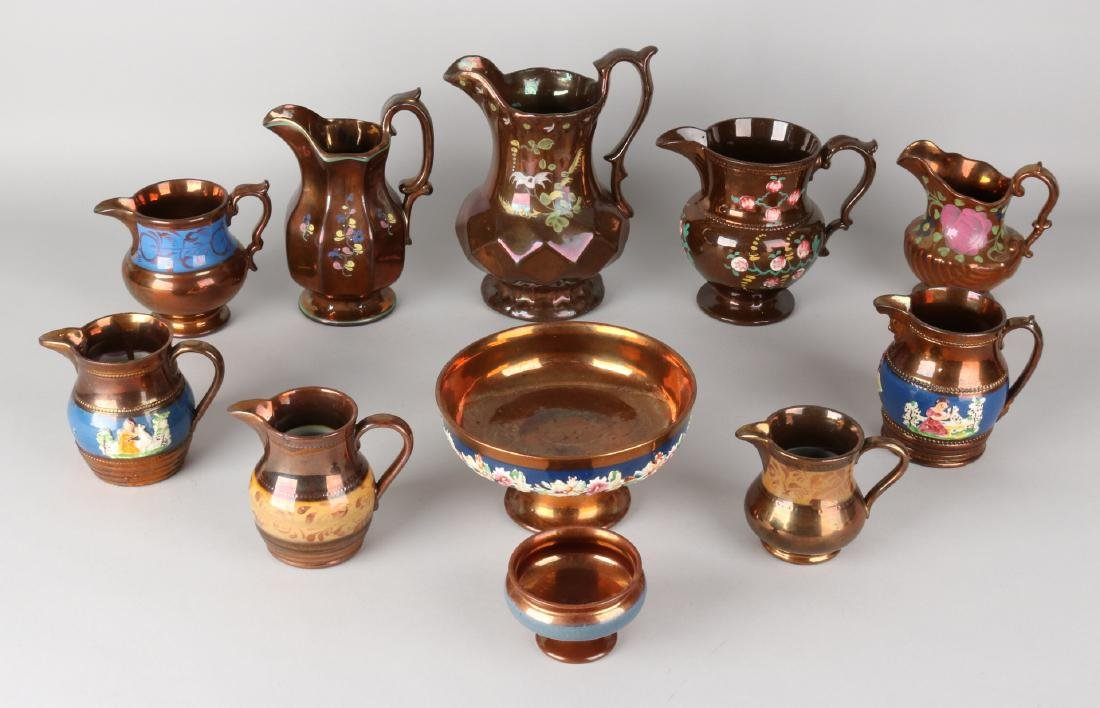 Eleven parts of 19th century goldstone ceramics. Divers. Among others: 9x jug, b