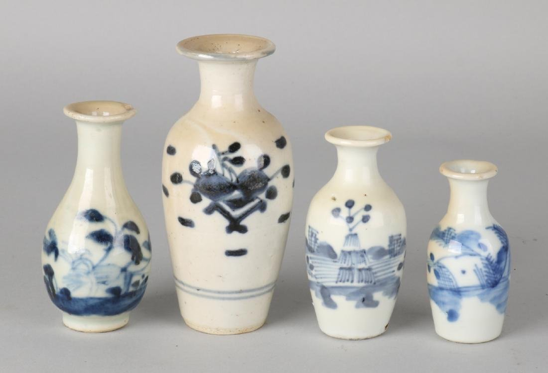 Four antique Chinese porcelain vases with various blue decors. Three vases of ch