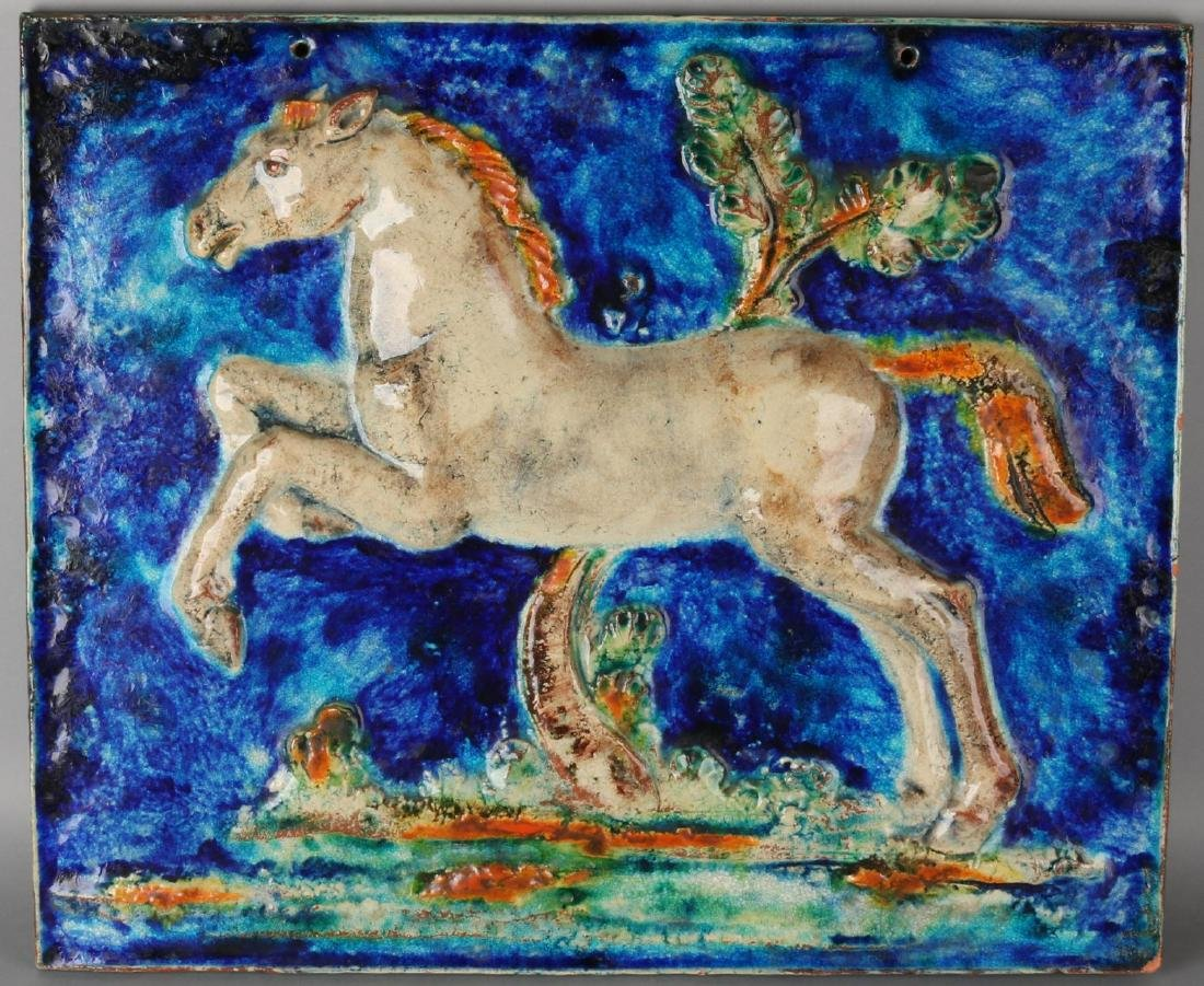 Very large Karlsruhe majolica wall plaque with horse. 20th century. In the color