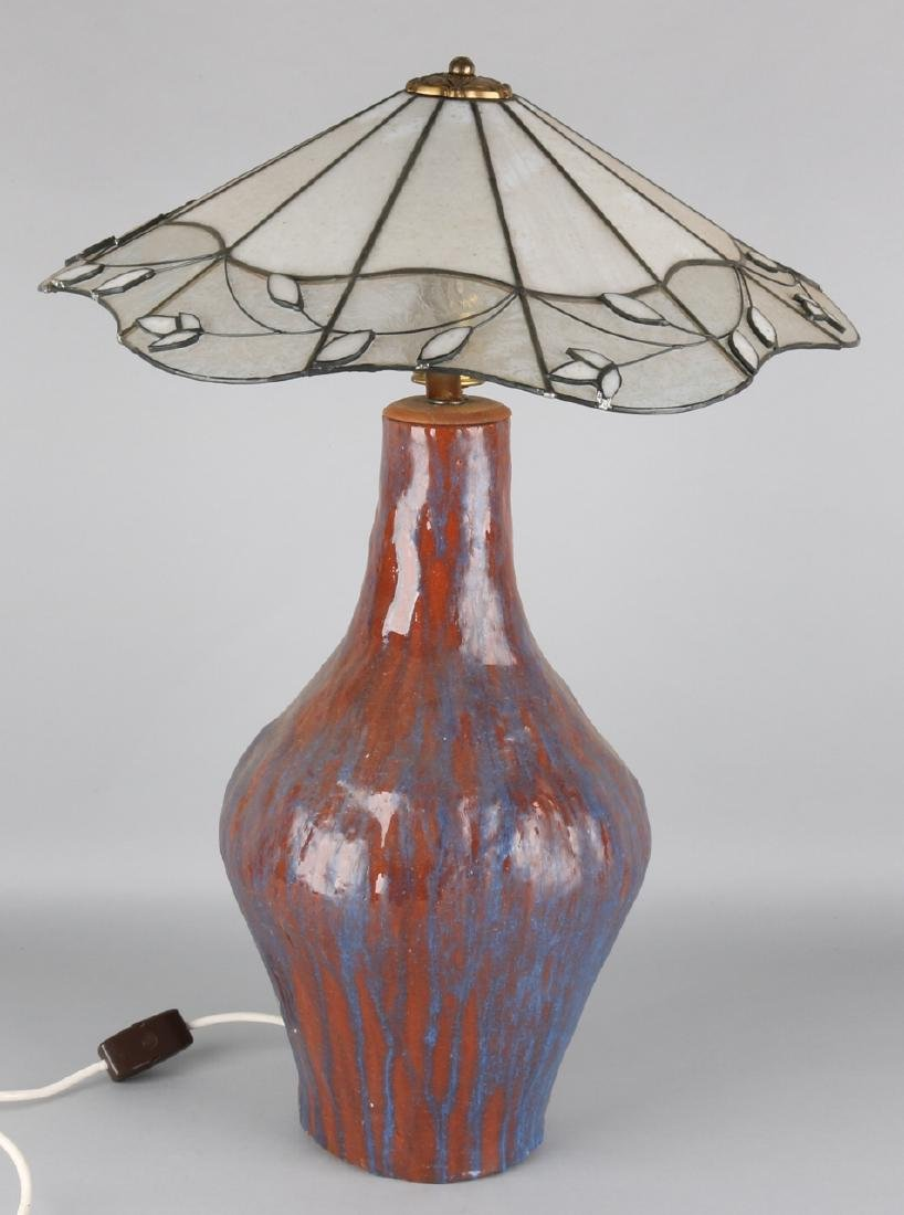 Large glazed ceramic table lamp with Tiffany-style lampshade. Second half of the