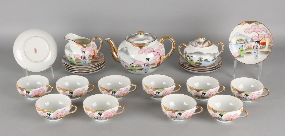 Antique Japanese eggshell porcelain tea set with figures in landscape scenery. C