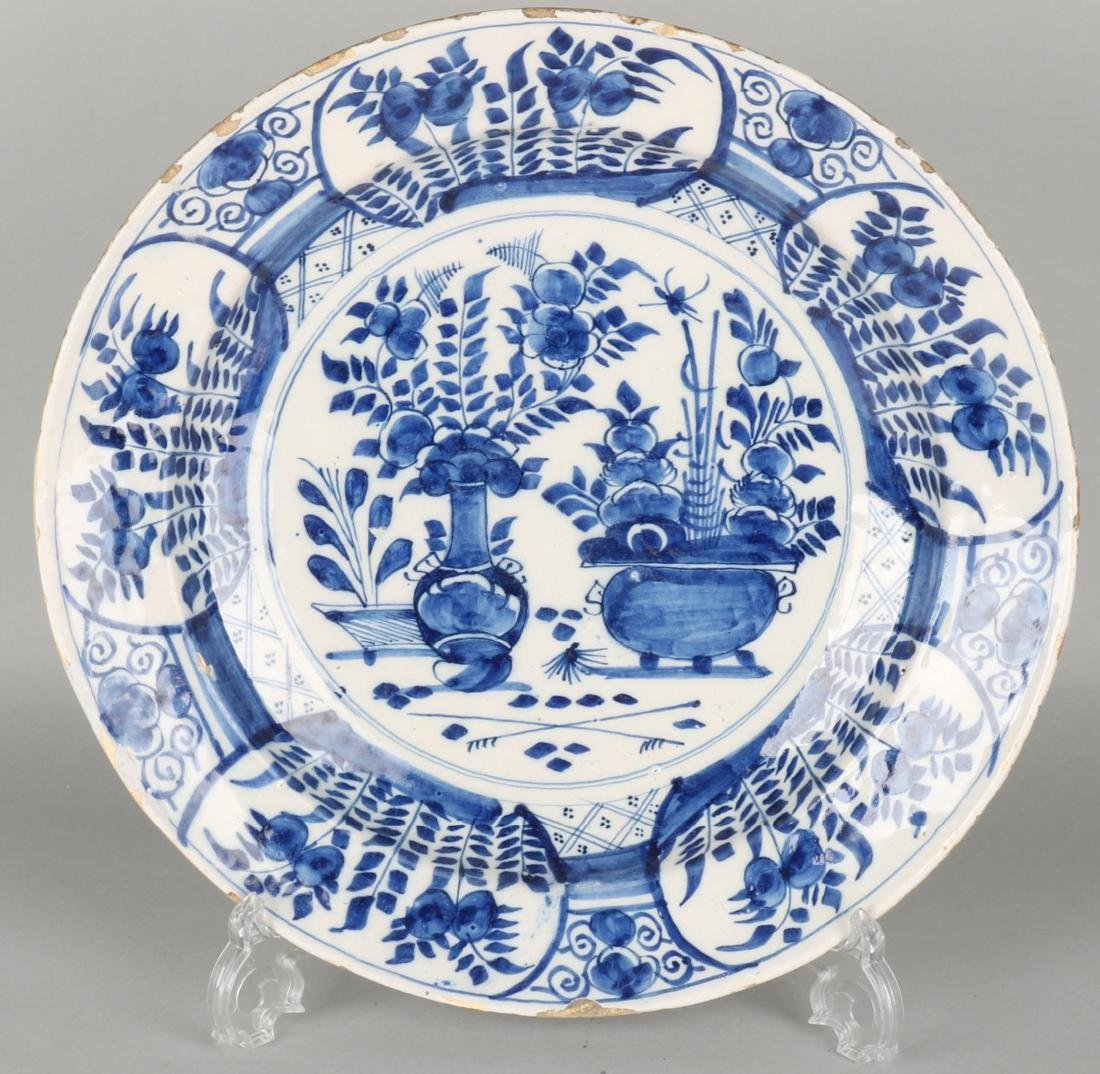 Large 18th century Delft plate with chinoiserie decor. Edge glaze damage. Size: