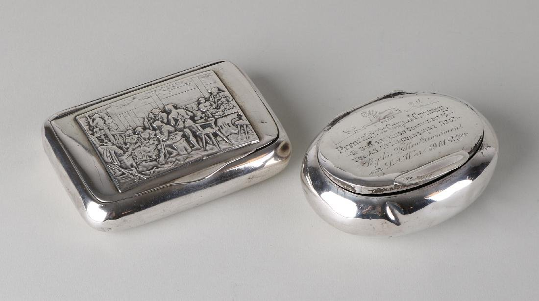 Two silver boxes with engraving, a rectangular box with