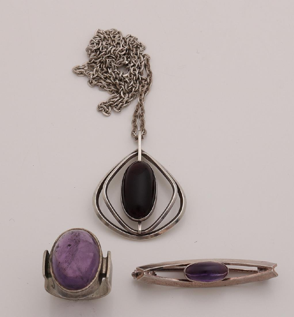 Silver jewelry with purple stone, a ring with an oval
