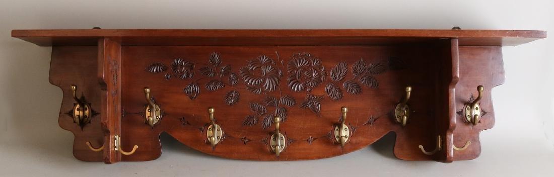 Jugendstil notch coat rack with brass hooks. Circa