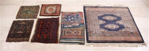 Six various old / antique Persian small rugs. Among