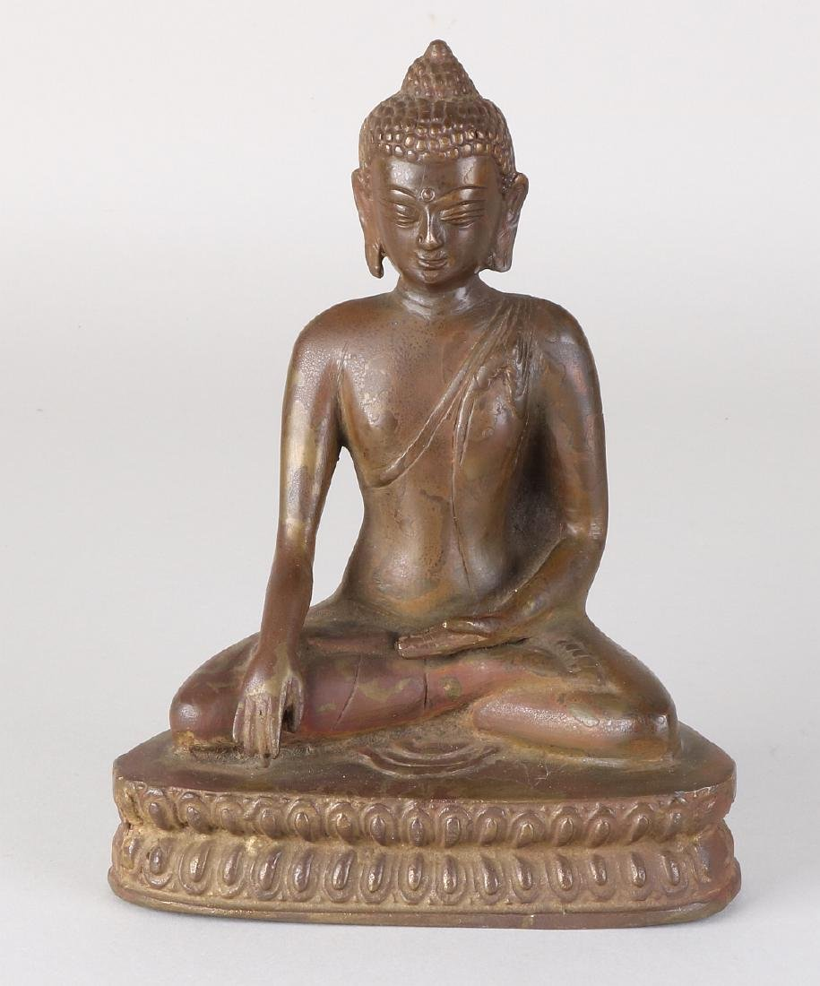 Ancient Oriental seated bronze Buddha figure on lotus