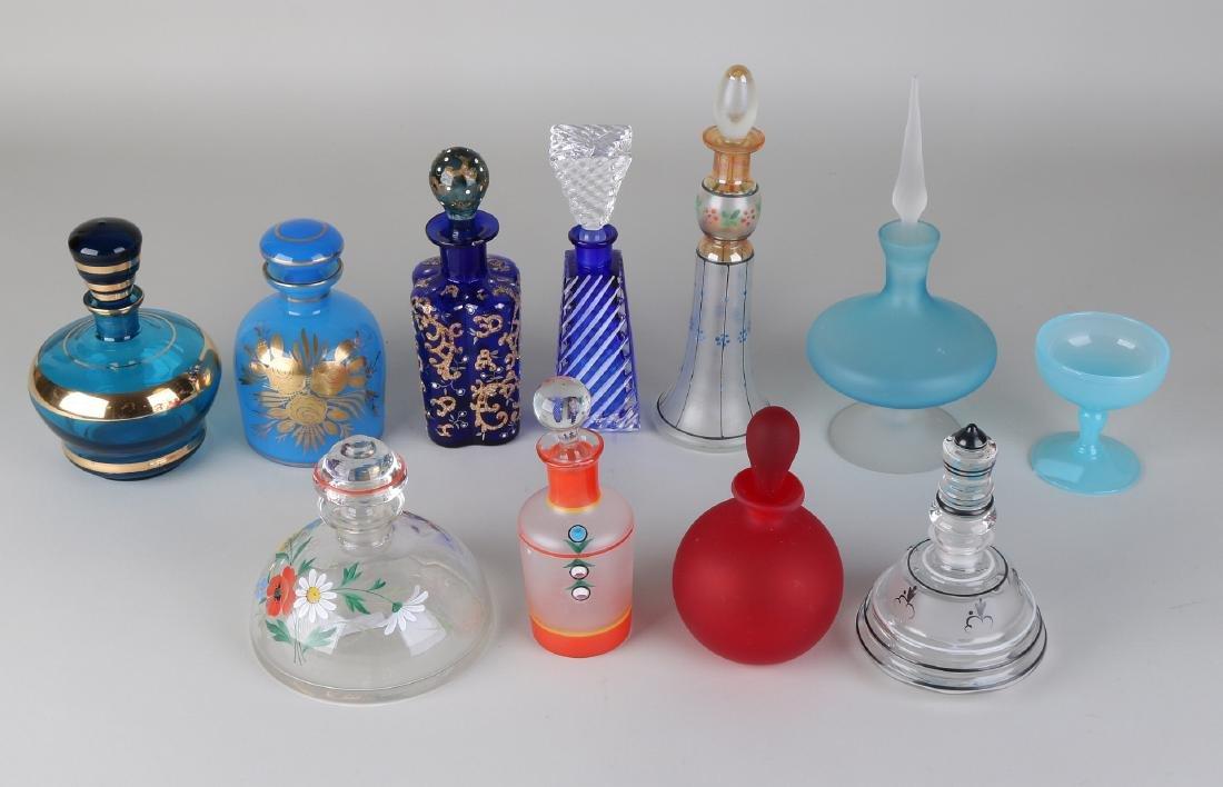 Eleven times various bottles / perfume bottles in