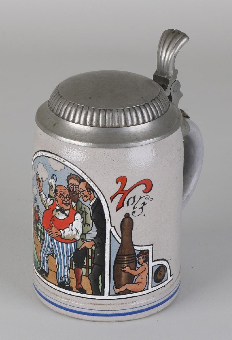 Antique German stoneware beer jug with pewter lid. Gut