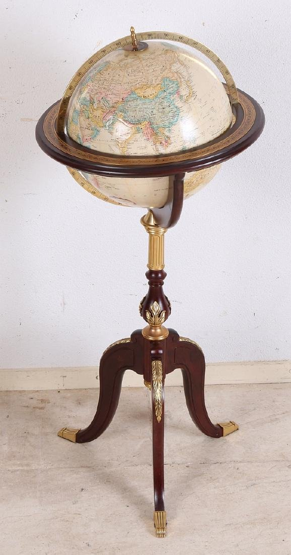 Decorative world globe on wooden stand. With brass